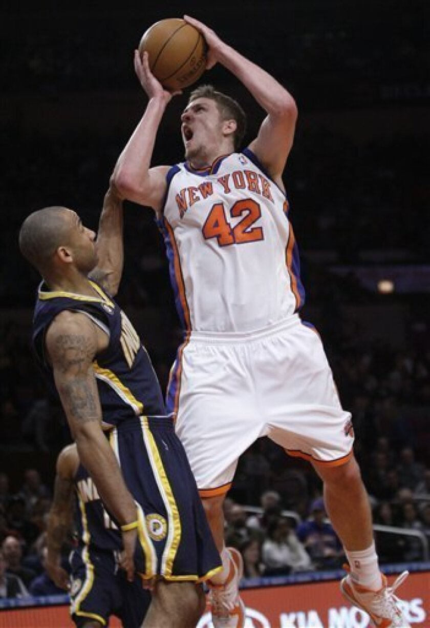 New York Knicks' David Lee (42) is fouled while shooting against Indiana Pacers' Dahntay Jones in the first quarter of an NBA basketball game on Sunday, Sunday, Jan. 3, 2010, at Madison Square Garden in New York. (AP Photo/Julie Jacobson)