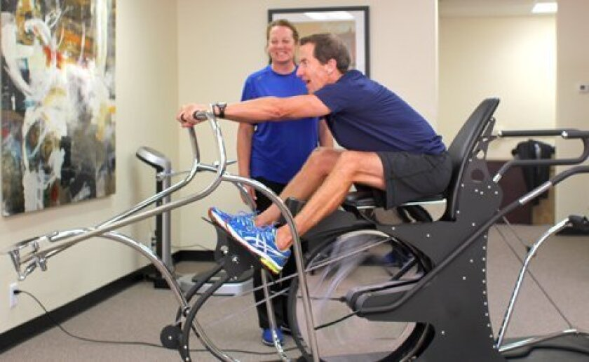 """""""This the best anaerobic exercise machine available,"""" says Mike Gotfredson, CEO of Roadrunner, using the patented Myo Metrix method at La Jolla Wellness Studio. Courtesy Photo"""