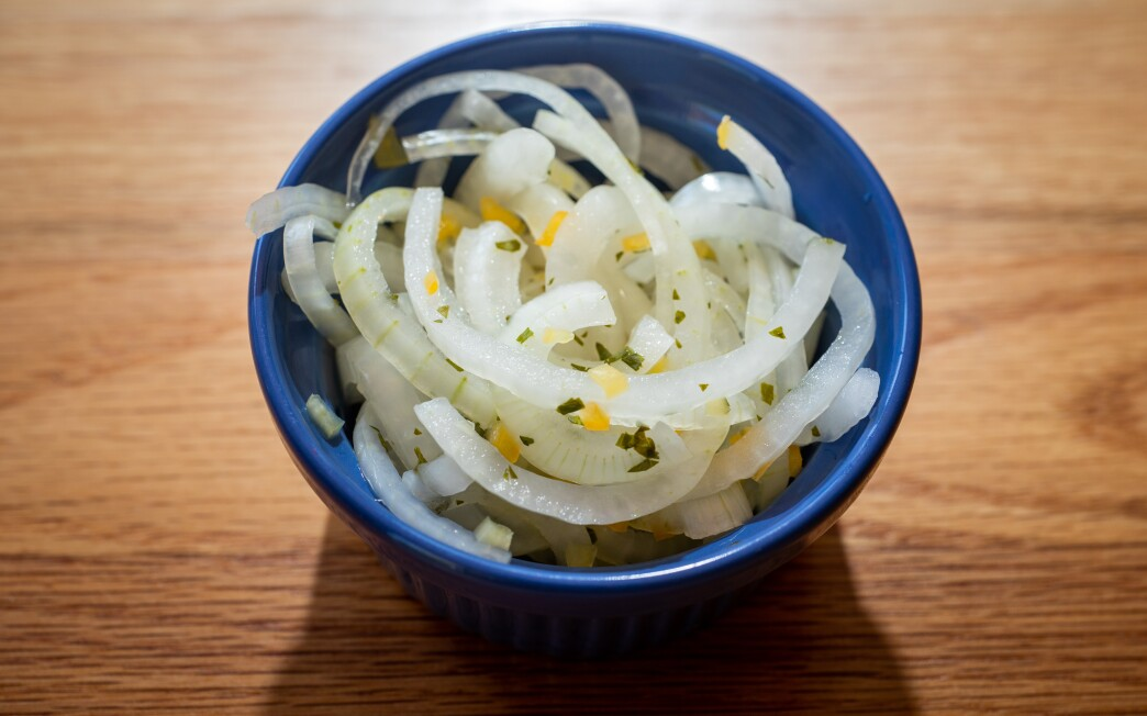 Piquant aji amarillo chiles lend their color and distinctive heat to these pickled white onions