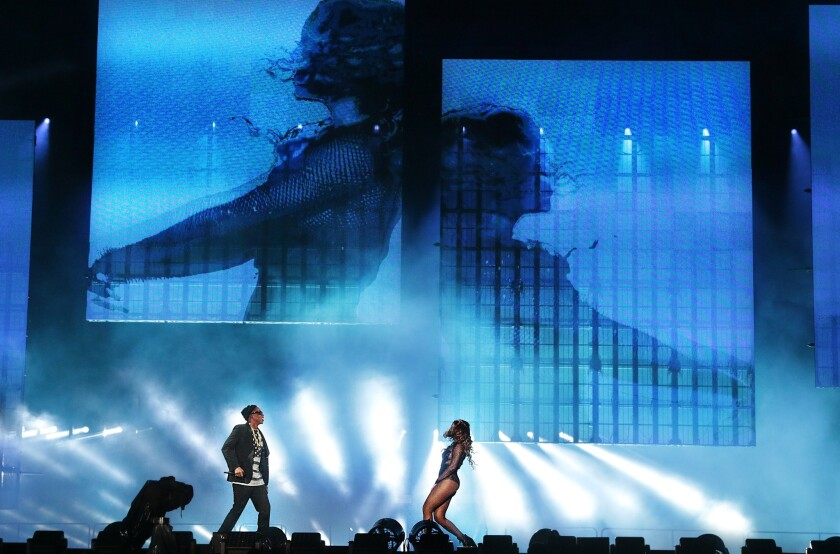 Jay Z and Beyonce perform at the Rose Bowl in Pasadena on Saturday, when an altercation between fans led to one man biting another, police said.
