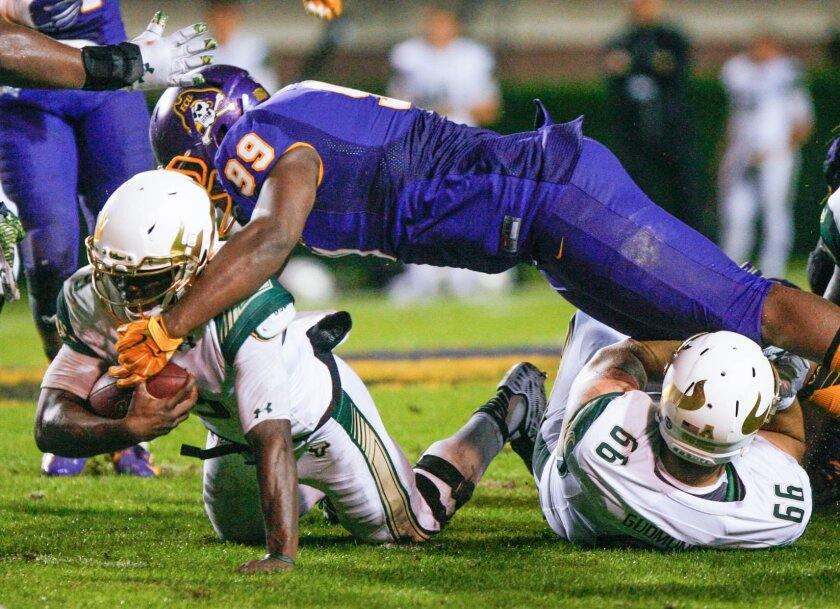 East Carolina's Fred Presley tackles South Florida's Deatrick Nichols during the first half of an NCAA college football game in Greenville, N.C. on Saturday, Nov. 7, 2015. (Bayardo Caceres-Rossel/The Daily Reflector via AP)