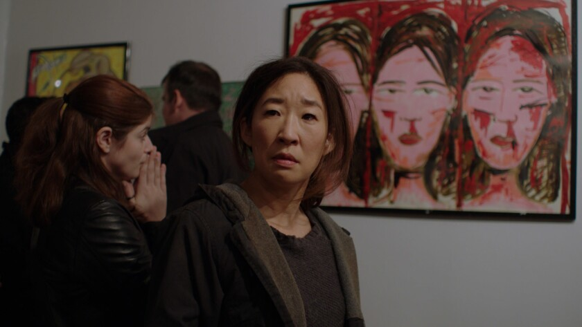 "Sandra Oh in the film ""Catfight."""