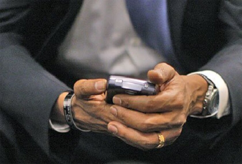 The Secret Service will allow President  Barack Obama limited use of his  beloved BlackBerry. (Jae C. Hong / AP file)