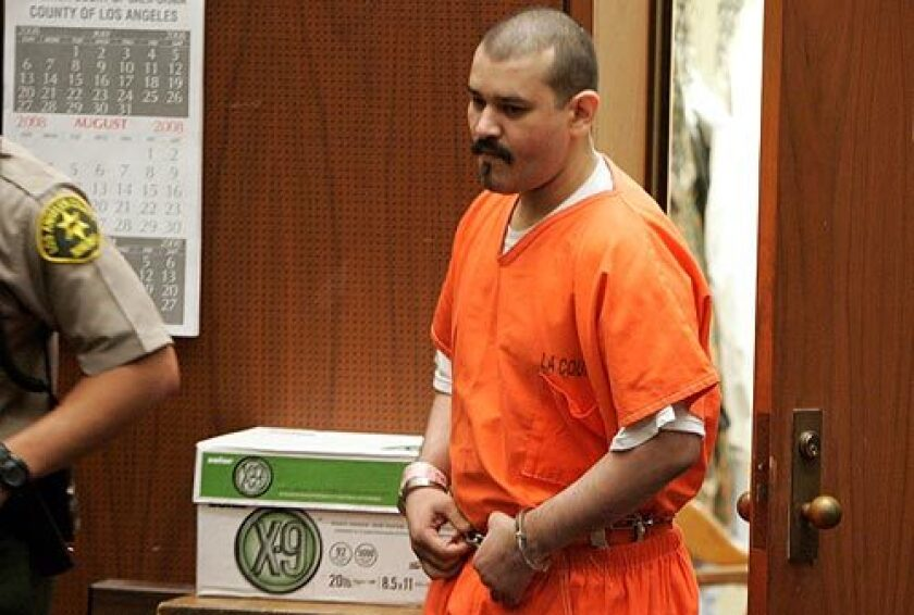 """Juan Manual Alvarez enters the courtroom, where Los Angeles County Superior Court Judge William R. Pounders tells him, """"If there were a sentence 'forever,' I would certainly give it to you."""""""