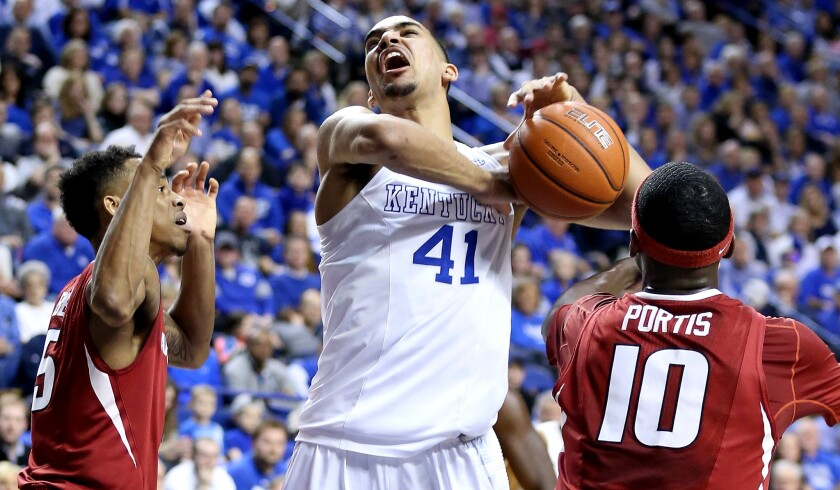 Kentucky forward Trey Lyles is fouled as he tries to score inside against Arkansas on Saturday.