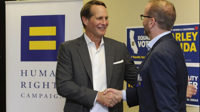 Harley Rouda, left, accepts an endorsement from Human Rights Campaign President Chad Griffin on Aug. 3 Huntington Beach.