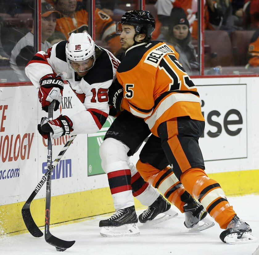New Jersey Devils' Jacob Josefson, left, and Philadelphia Flyers' Michael Del Zotto battle for the puck during the first period of an NHL hockey game, Saturday, Feb. 13, 2016, in Philadelphia. (AP Photo/Matt Slocum)