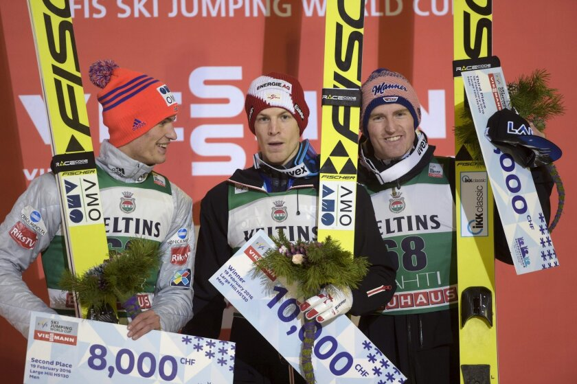 From left, second placed Daniel Andre Tande of Norway, winner Michael Hayboeck of Austria and third placed Severin Freund of Germany celebrate on the podium after the Ski Jumping HS130 World Cup competition at the Lahti Ski Games, the Pre-World Championships, in Lahti, Finland, Friday, Feb. 19, 201