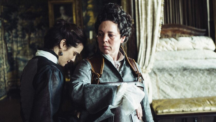 "Rachel Weisz and Olivia Coleman, right, in a scene from the film ""The Favourite."""