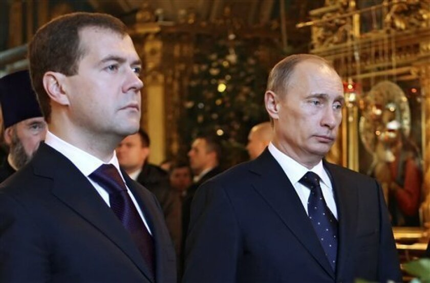 Russian President Dmitry Medvedev, left, and Prime Minister Vladimir Putin stand at the Tomb of late Russian Orthodox Patriarch Alexy II at the  Epiphany Cathedral in Moscow, in a Tuesday, Jan. 13, 2009 photo. President Dmitry Medvedev twice has rebuked the government led by his predecessor Vladimi
