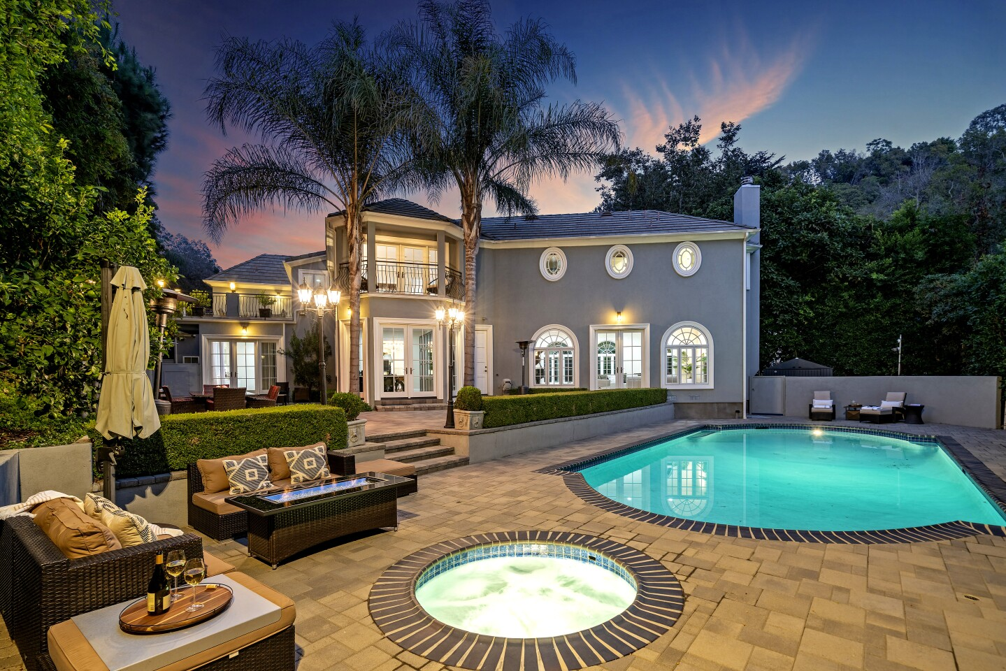 Built in the 1920s for Golden Age of Hollywood actor Errol Flynn, the stylish estate includes a secluded backyard dotted with vintage lampposts and outdoor heaters.