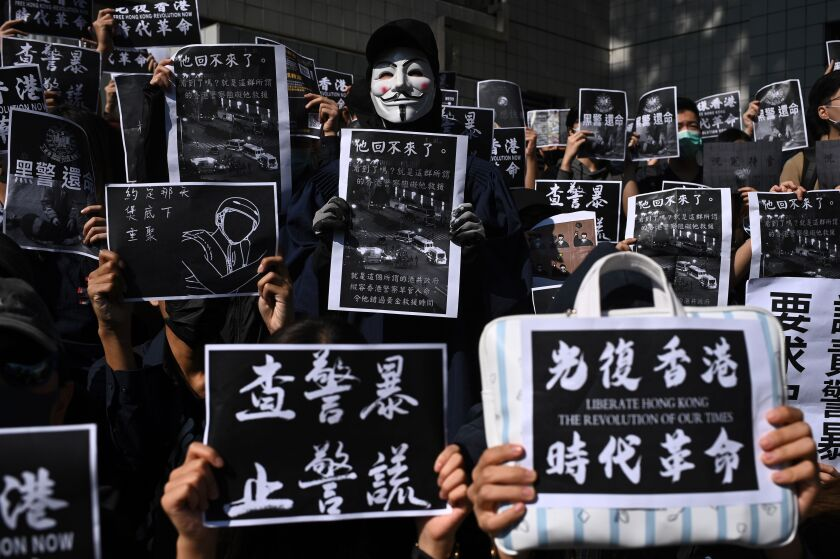 Students from Hong Kong University of Science and Technology, where 22-year-old Alex Chow Tsz-lok studied, take part in a march Nov. 8.