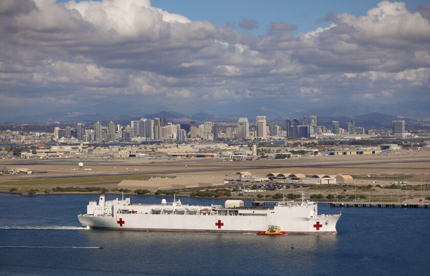 The hospital ship USNS Mercy with it's staff of 800 Navy medical personnel and support staff, along with more than 70 civil service mariners departed Naval Base San Diego as it makes it way out of San Diego Bay on Monday, March 23, 2020. The Mercy will serve as a referral hospital for non COVID-19 patients.