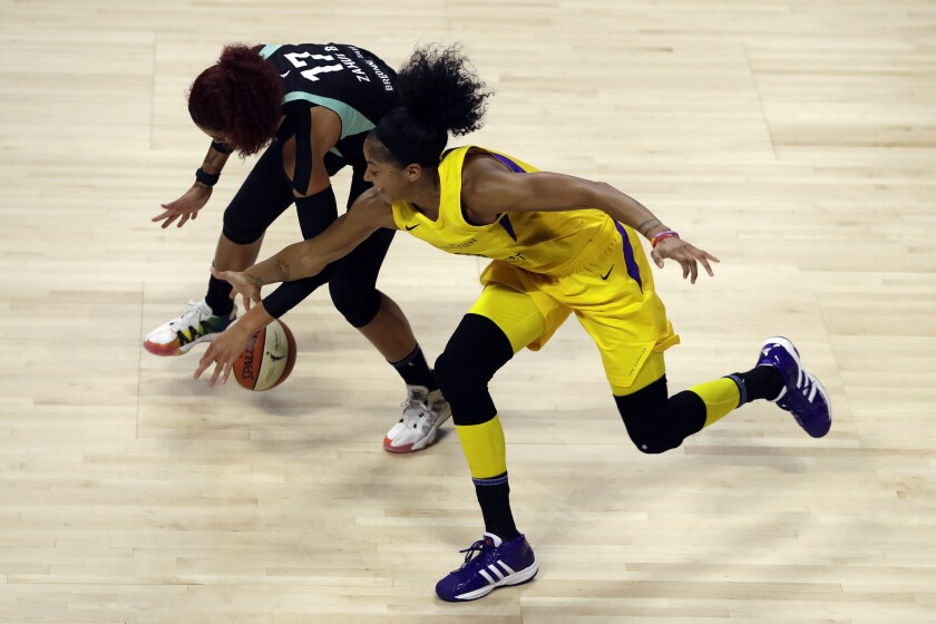 Sparks forward Candace Parker steals the ball from New York Liberty center Amanda Zahui B. on Aug. 11 in Bradenton, Fla.
