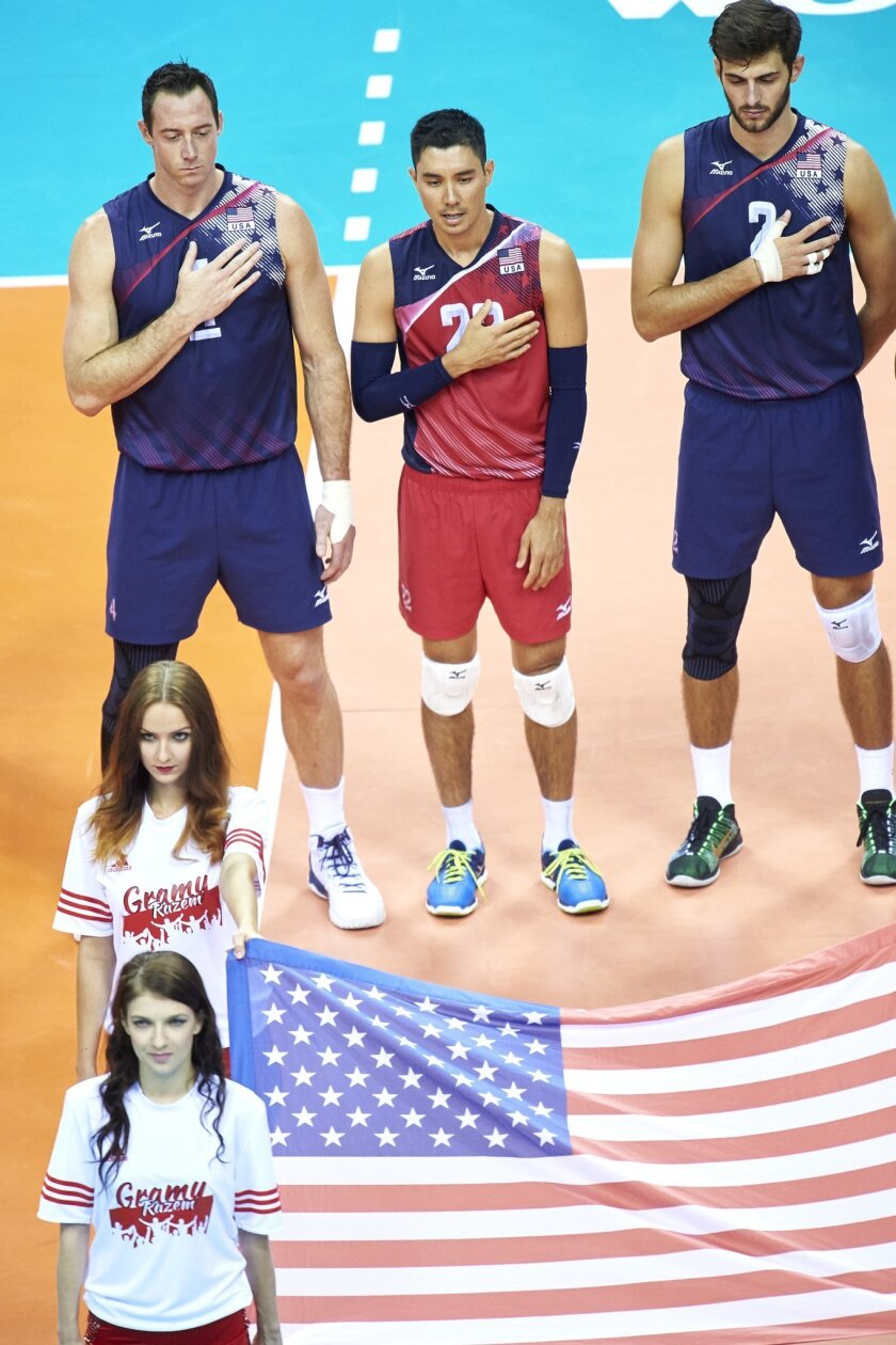 KRAKOW, POLAND - JULY 15: David Lee C from USA and David Smith from USA and Aaron Russell from USA sing national anthem while the FIVB World League volleyball match between Brazil and USA at Tauron Arena on July 15, 2016 in Krakow, Poland. (Photo by Adam Nurkiewicz/Getty Images for FIVB) ** OUTS -