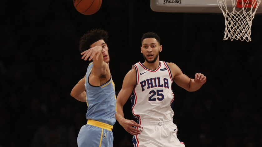 Then-Lakers guard passes to a teammate after having a drive cut off by 76ers forward Ben Simmons.