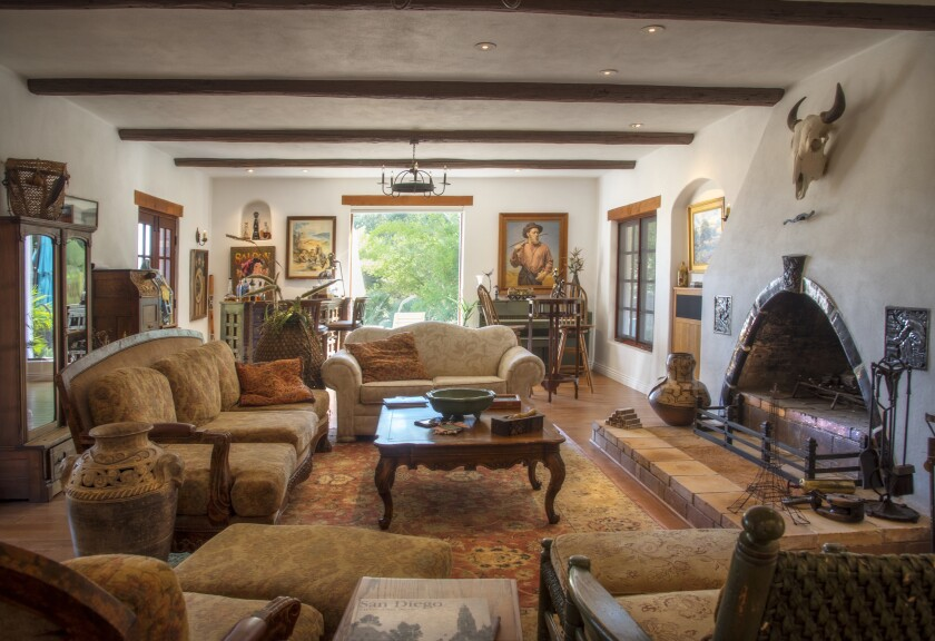 Richard Adobe's expansive living room overlooks the gardens and views beyond.