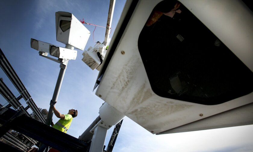 New categories of public employees and family members would be eligible for a confidential records program that lets drivers evade red-light cameras, toll-road fines and other traffic laws.
