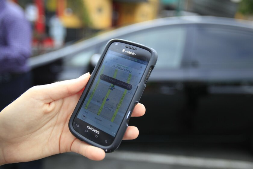 Passengers who use UberX, Lyft, Sidecar and other ridesharing companies download a smartphone app to connect with drivers. Photo by John Gastaldo/U-T San Diego.