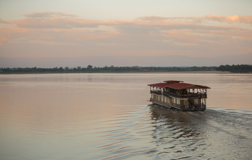 The Vat Phou boat, a floating hotel cruising on the Mekong river in southern Laos