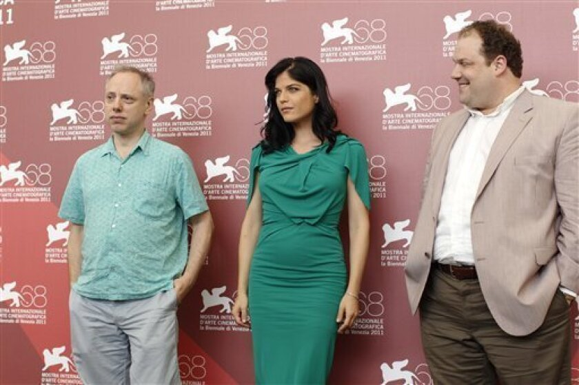 From left, director Todd Solondz, actress Selma Blair, and actor Jordan Gelber pose during the photo call for the movie Dark Horse at the 68th edition of the Venice Film Festival in Venice, Italy, Monday, Sept. 5, 2011. (AP Photo/Andrew Medichini)