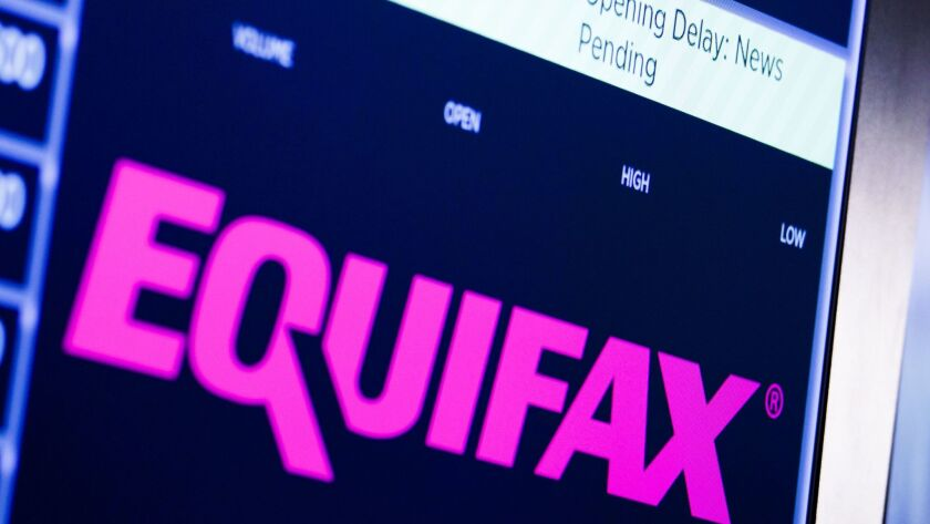 A sign at the New York Stock Exchange for Equifax.