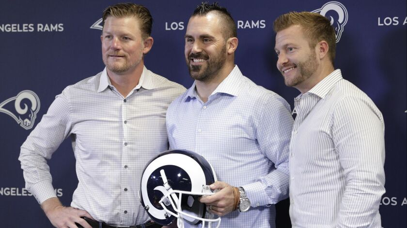 THOUSAND OAKS, CA -- MARCH 12, 2018: Los Angeles Rams general manager Les Snead, left, with new safe