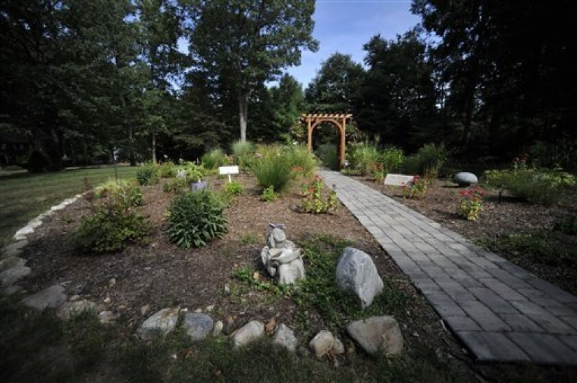 In this Sept. 7, 2010 photo, a remembrance garden is in place where the house of the Petit family once stood in Cheshire, Conn. In July 2007, intruders broke into the Petit family home and held the family hostage for several hours before setting the house on fire. Dr. William Petit Jr., was severely beaten, and his wife and two daughters were killed. A trial begins Monday, Sept. 13, 2010 in New Haven, Conn., Superior Court for Steven Hayes, one of two men charged with the crimes. (AP Photo/Jessica Hill)