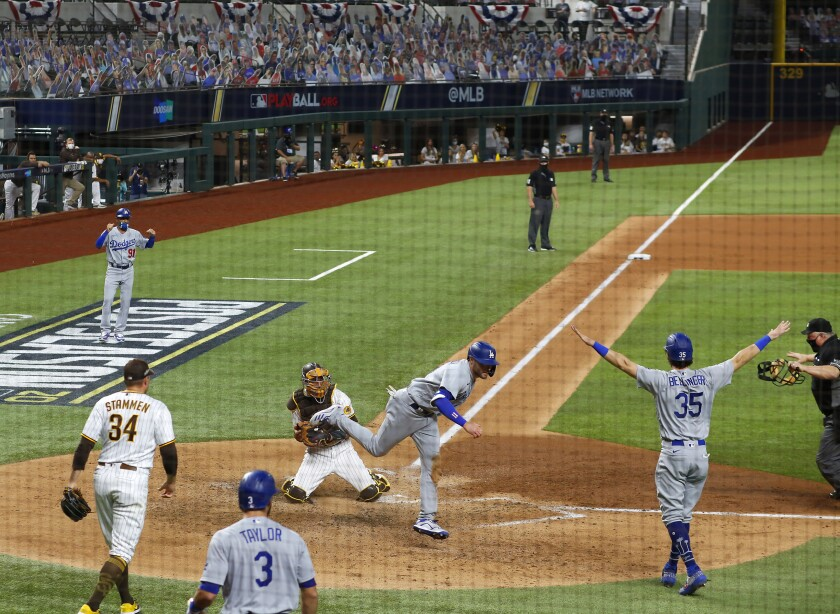 A.J. Pollock scores during the Dodgers' five-run third inning in Game 3 of the National League Division Series.