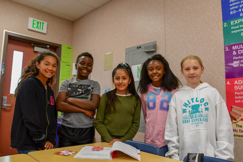 Foussat Elementary students Makana' Nalani Kawehio'Napua, Earl Johnson, Keila Velasco, Iona Ezell and Scarlett Guise were among those who recently raised money to help families affected by the Crown Heights fire.