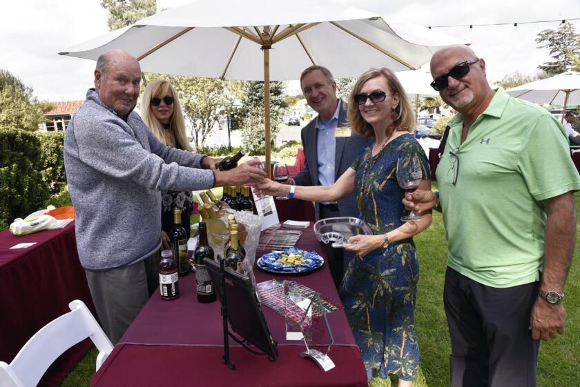 Pegasus Estate Winery (www.pegasusestatewinery.com) proprietor Michael Crowley, with assistant Lisa Hewitt, serves Rotary Part President Greg Grajek and Cindy Grajek, Tony Khalil