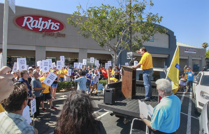 United Food and Commercial Workers Local 135 President Todd Walters speaks at a rally outside the Ralphs grocery store in San Diego's Mission Valley area.