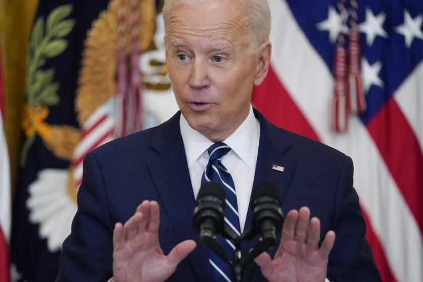 President Joe Biden speaks during a news conference in the East Room of the White House Thursday.