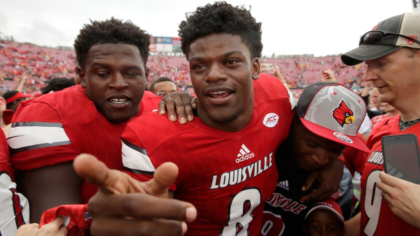 Quarterback Lamar Jackson (8) celebrates after Louisville's dismantling of Florida State on Saturday.