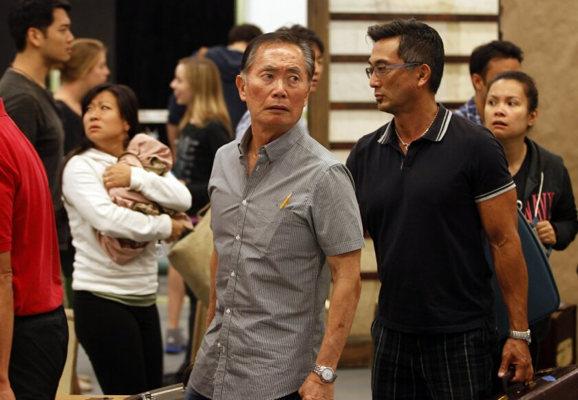 Actor George Takei (center), shown last month during a rehearsal at the Old Globe Theatre, will speak Monday afternoon at High Tech High about the internment of 120,000 Japanese-Americans during World War II. / Photo by Eduardo Contreras * U-T San Diego