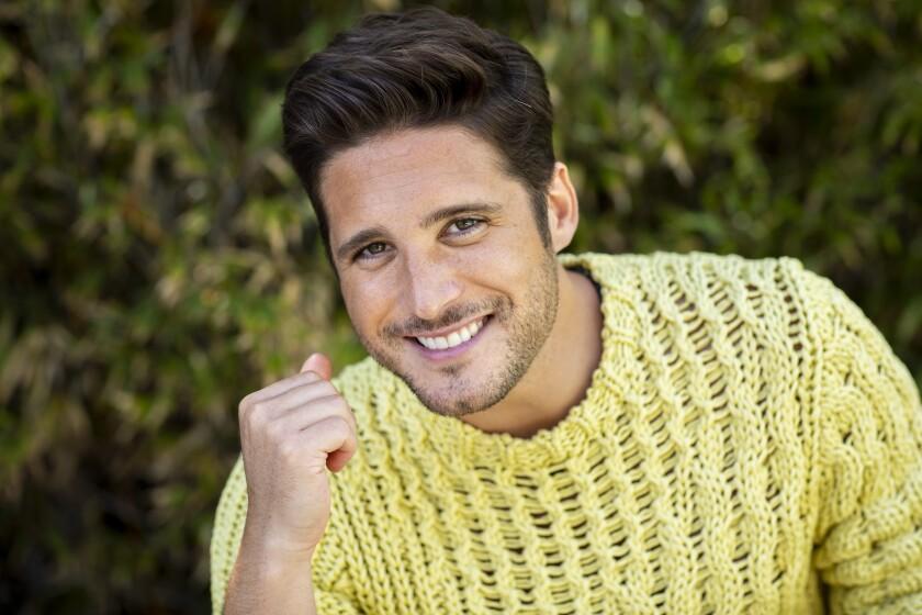 Actor Diego Boneta in a yellow sweater