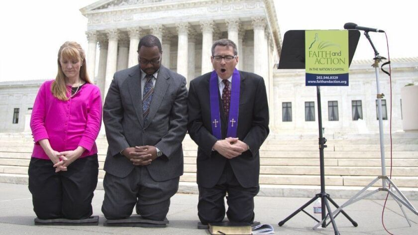 Christian activists pray in front of the Supreme Court after the justices ruled in favor of the Town of Greece, N.Y., in a public prayer case on May 5, 2014.