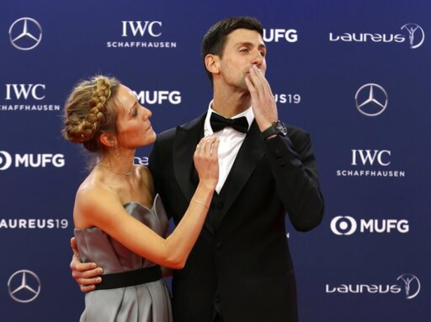 FILE - In this Monday, Feb. 18, 2019 file photo Serbian tennis player Novak Djokovic and his wife Jelena arrive for the 2019 Laureus World Sports Awards. Novak Djokovic has tested positive for the coronavirus after taking part in a tennis exhibition series he organized in Serbia and Croatia. The top-ranked Serb is the fourth player to test positive for the virus after first playing in Belgrade and then again last weekend in Zadar, Croatia. His wife also tested positive. (AP Photo/Claude Paris, File)