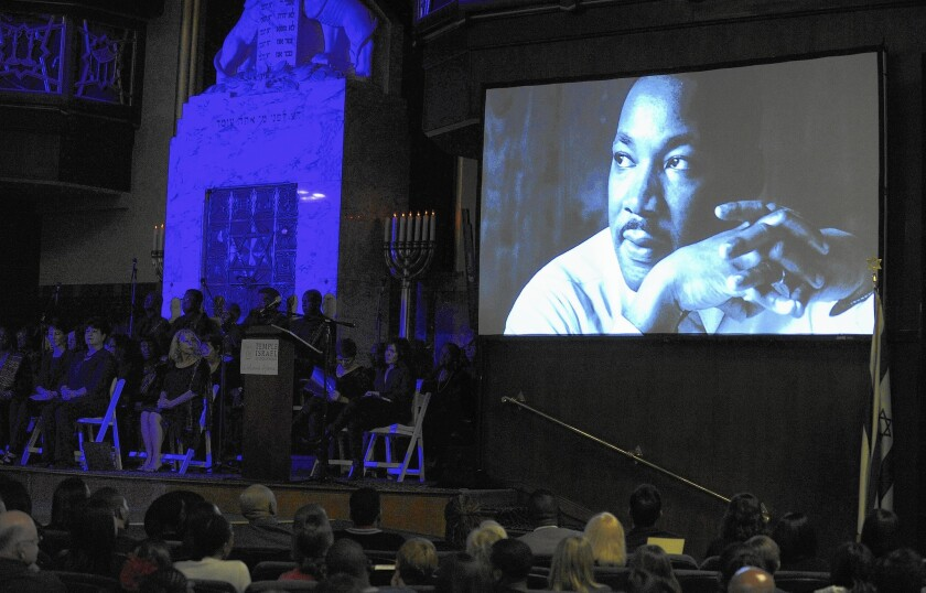 An image of Dr. Martin Luther King Jr. is displayed Sunday night during the 50th anniversary of a speech that he gave at the Temple Israel of Hollywood.