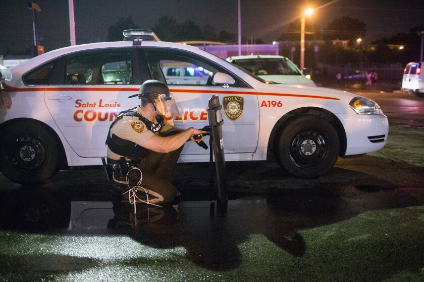Gunfire erupts during an Aug. 9 demonstration marking the first anniversary of the shooting of Michael Brown in Ferguson, Mo.