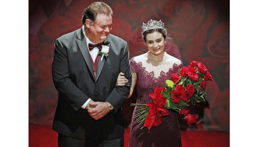 Rose Princess Helen Susan Rossi, of Flintridge Preparatory School, with her father Philip, walk onto
