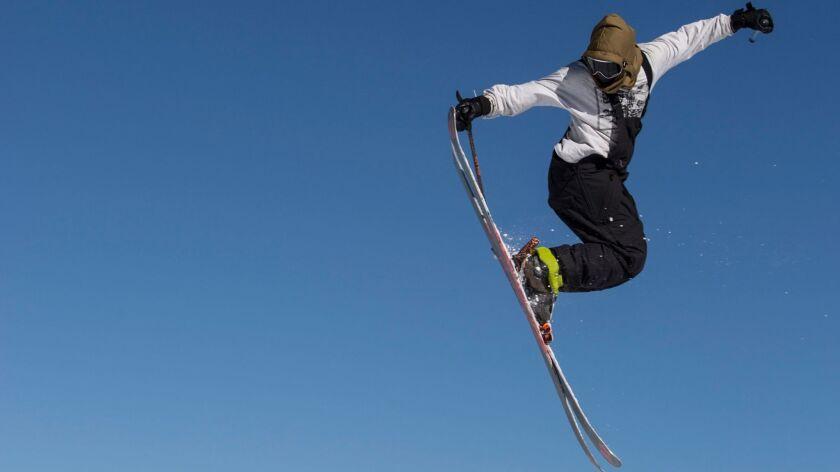 A skier gets a lot of air off of a jump at the Unbound Main Park at Mammoth Mountain in Mammoth Lakes, Calif.
