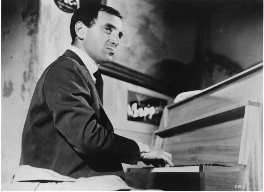 "Charles Aznavour in Francois Truffaut's 1960 film ""Shoot the Piano Player,"" based on David Goodis' 1956 novel ""Down There."""