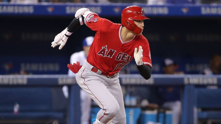 The Angels' Shohei Ohtani runs to first base during a game against the Toronto Blue Jays on June 17. Ohtani is a tourism magnet for the team and the city of Anaheim.