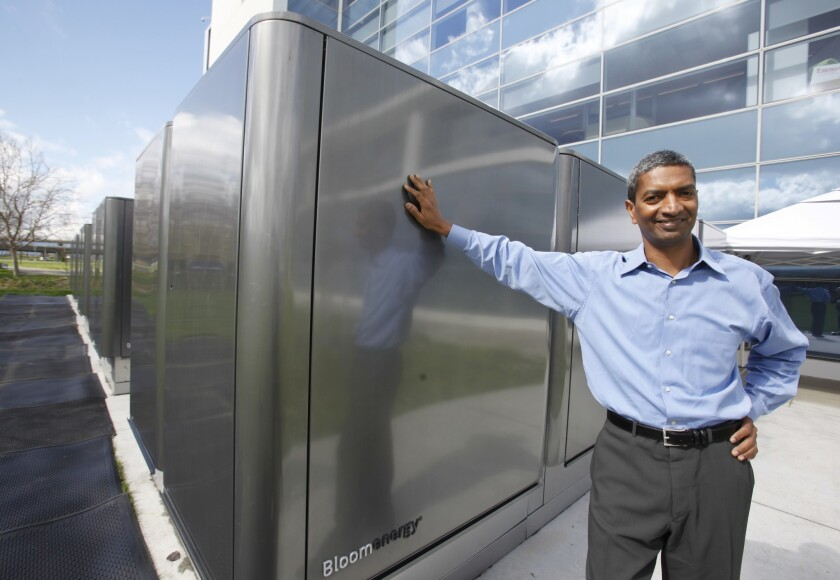 KR Sridhar, co-founder and CEO of Bloom Energy, poses next to Bloom Energy power servers at eBay offices in San Jose, Wednesday, Feb. 24, 2010.