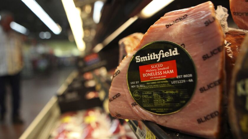FILE - In this Sept. 6, 2011 file photo, shows a Smithfield ham at a grocery store in Richardson, Te