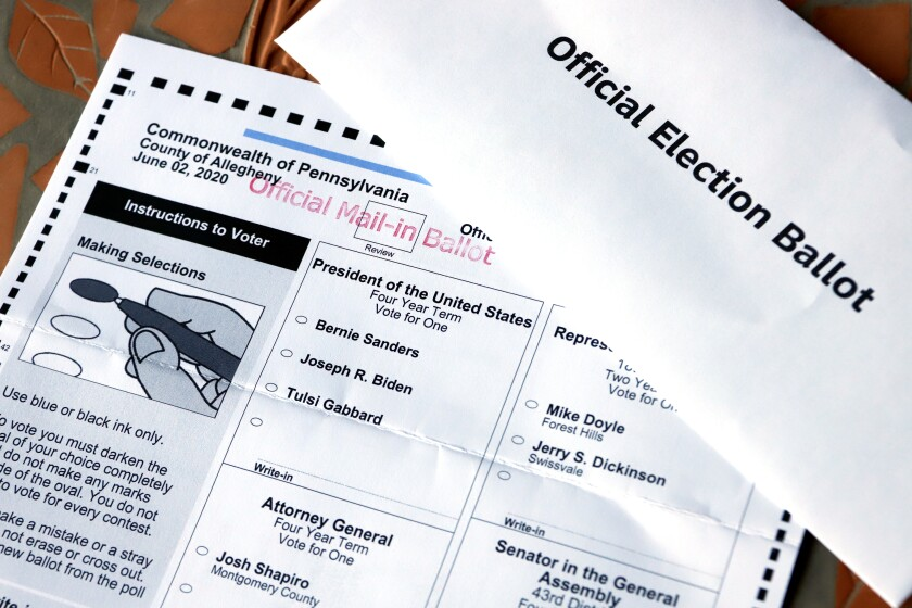FILE - This May 26, 2020, file photo shows an Official Democratic General Primary mail-in ballot and secrecy envelope, for the Pennsylvania primary in Pittsburgh. Amid the global pandemic, more people than ever are expected to bypass their polling place and cast absentee ballots for the first time. Voters marking ballots from home could lead to an increase in the kinds of mistakes that typically would be caught by a scanner or election worker at the polls. (AP Photo/Gene J. Puskar, File)