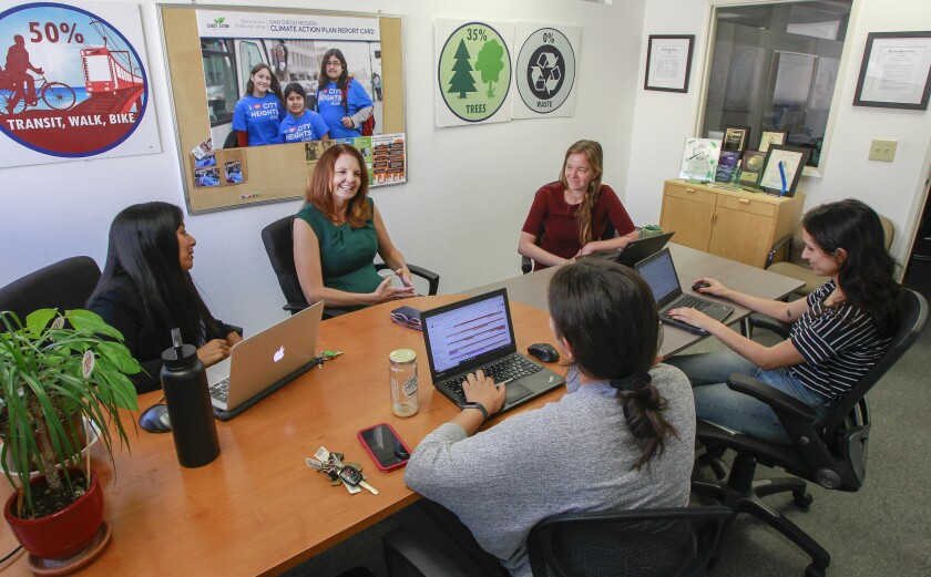 Nicole Capretz, founder and executive director of Climate Action Campaign and her team  working on their annual report card