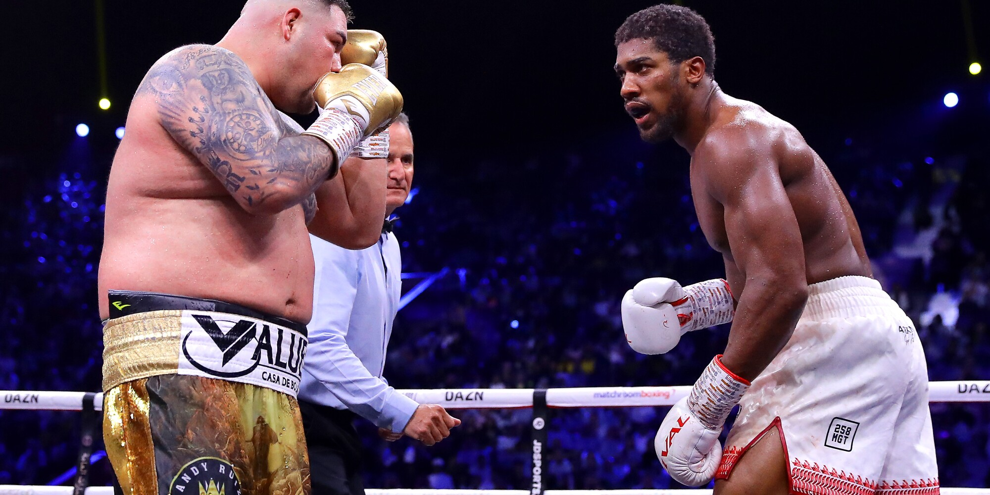 Anthony Joshua, right, taunts Andy Ruiz Jr. during their heavyweight title match Dec. 7, 2019, in Saudi Arabia.