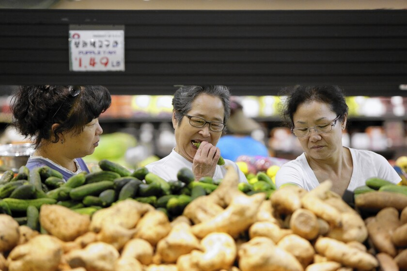 Jenny Kim, left, Cherry Shim and Young Casey shop at Super 1 Mart in La Palma. Orange County now has the third-largest Asian American population nationwide, and La Palma is the county's first Asian-majority city.